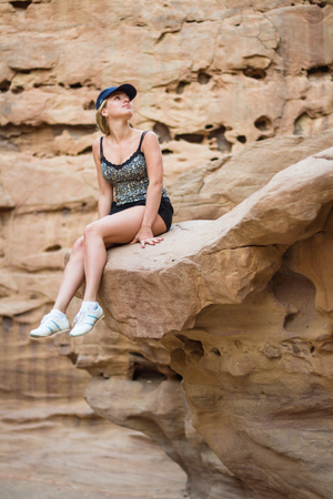 Beautiful girl sitting on a rock in Red Canyon  Israel photo