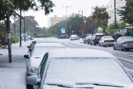RAMLA , ISRAEL - DECEMBER 13 , 2013 : Israeli street covered with snow.