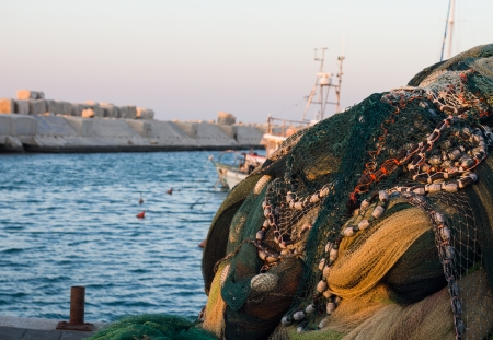 Fishing nets in the port of Jaffa old on water background. Israel. photo