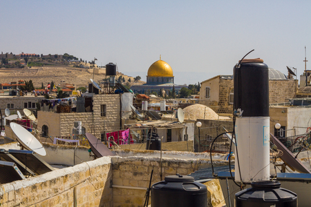 Beautiful photo Dome of the Rock on the background of the roofs of houses, Jerusalem, Israel photo