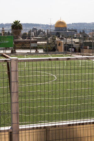 Photo of a football field in the old city of Jerusalem on a background of Al-Aqsa Mosque  photo