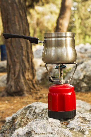 Making coffee on a gas burner on the nature. photo