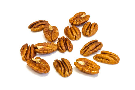 anti oxidants: Heap of  Pecan nuts pile on white background , macro image . Stock Photo
