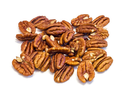 Heap of  Pecan nuts pile on white background , macro image . Reklamní fotografie
