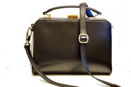 Black leather female handbag. isolated on white . Stock Photo - 27712772