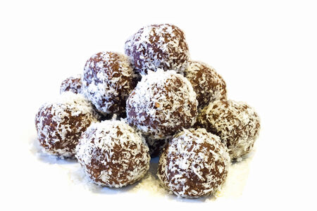 Chocolate balls - topped with grated coconut .