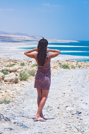 Young woman going to Dead Sea, Israel photo