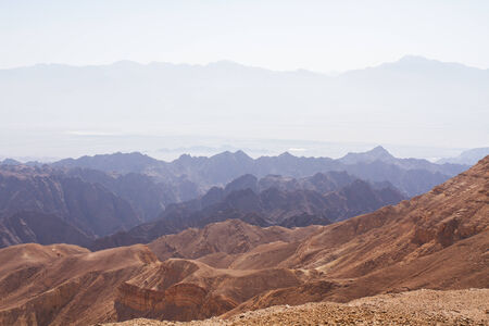 Early morning in ancient mountains of Sinai desert  Sunrise over Red sea photo