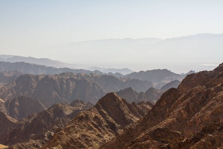 Early morning in ancient mountains of Sinai desert. Sunrise over Red sea photo