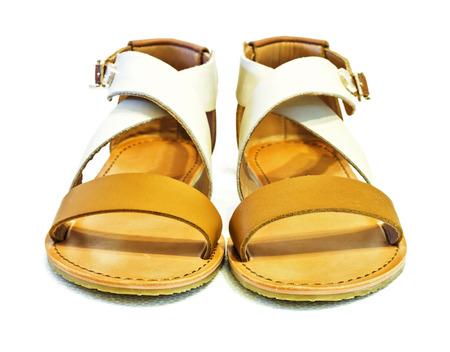 Beautiful photo of female leather sandals isolated on white background. photo
