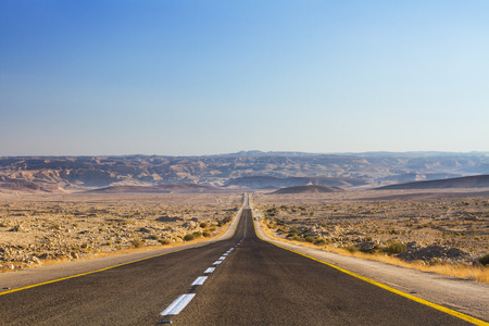 Beautiful road in the desert, going beyond the horizon. Israel