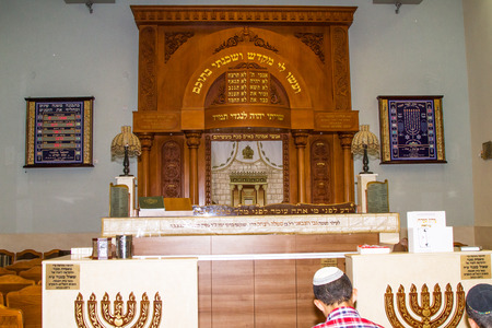 shul: Tel-Aviv , Israel - September 8 . 2014: The interior of the synagogue Kipusit in Tel Aviv. Israel.Designated congregation and the altar.  Editorial