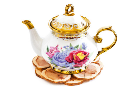 stand teapot: Beautiful photo of Ceramic teapot on Wooden stand .