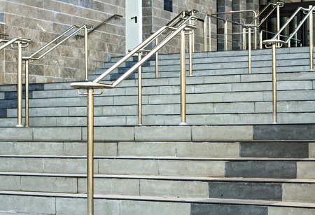 Stainless steel handrails are installed on the walls and steps. photo