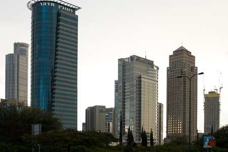 ramat aviv: Tel-Aviv , Israel - December 20 . 2014 : View from the Bridge Street Halacha in a southerly direction. View of the Diamond Exchange Tel - Aviv, Israel. Beautiful photos of the evening in Tel Aviv on a background of blue sky and clouds.