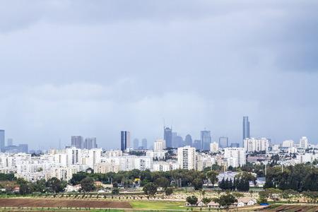 ramat aviv: Tel Aviv and  Ramat Gan Skyline during a thunderstorm  - Panoramic shot Editorial