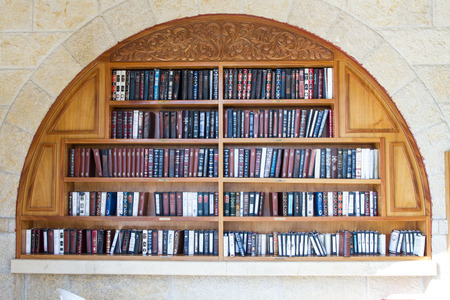 shul: Jerusalem , Israel - January 22, 2015 : Shelves with religious literature in the synagogue next to the Wailing Wall in Jerusalem.