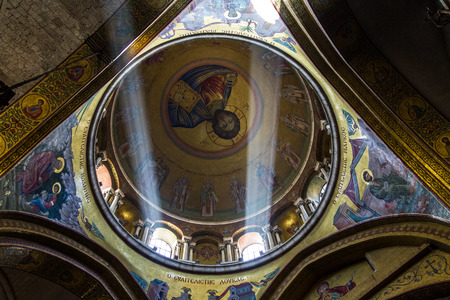 church of the holy sepulchre: Jerusalem , Israel - January 22, 2015:  The Holy Sepulchre Church in the Old City of Jerusalem. Light goes through the dome of the church. Editorial