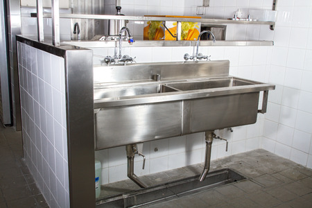 stainless steel sink: Professional kitchen, view counter in stainless steel . Stock Photo