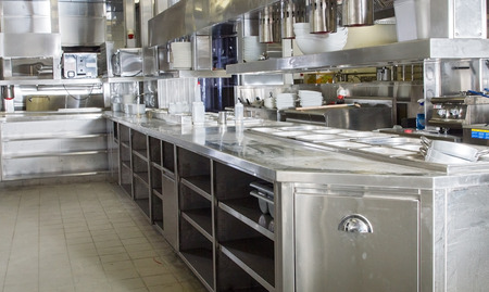 Professional kitchen, view counter in stainless steel . Standard-Bild