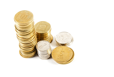 Coins of different denominations Israeli bank against white background . Standard-Bild