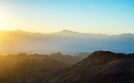 sinai: Early morning in ancient mountains of Sinai desert. Sunrise over Red sea Stock Photo