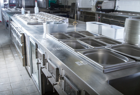 Professional kitchen, view counter in stainless steel . Stock fotó