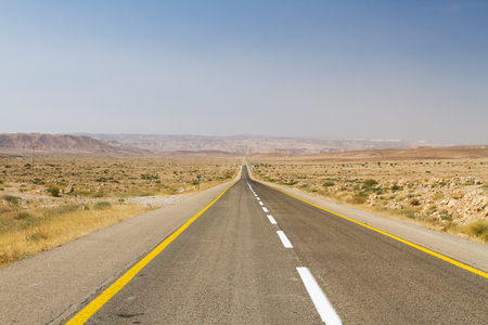 Beautiful road in the desert, going beyond the horizon. Israel . photo