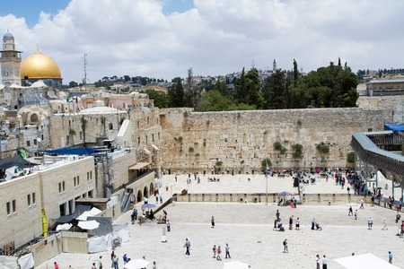 wailing: Jerusalem , Israel - June 20, 2015 : Beautiful photo at the Wailing Wall in the Old City of Jerusalem. The most holy place for Jews in the world . Many pilgrims can be seen on the photo. Israel.