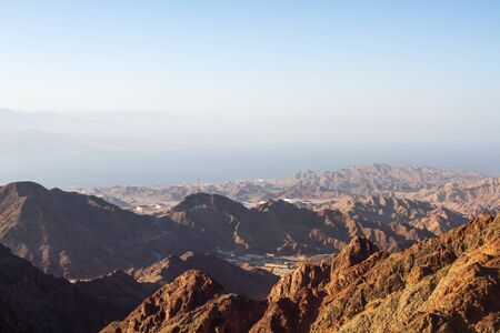 sinai desert: Early morning in ancient mountains of Sinai desert. Sunrise over Red sea Stock Photo