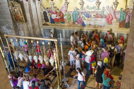 church of the holy sepulchre: Jerusalem , Israel - July 11, 2015 :  The Holy Sepulchre Church in the Old City of Jerusalem. Stone anointing of the Lord and a fresco of the crucifixion.
