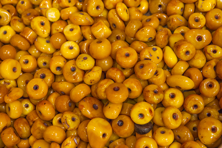 Israeli amber, which is obtained from the resin of palm trees and lain in the water for about 40 years. Arab market in Jerusalem. Israel. Stock Photo