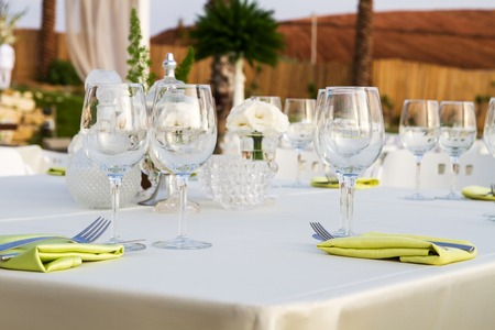 event: Table set for wedding or another catered event dinner .