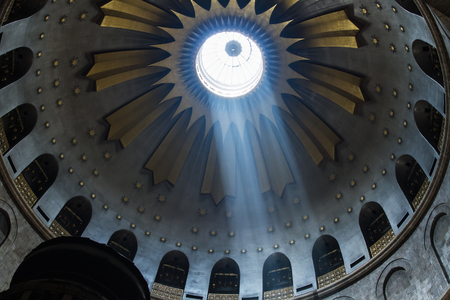 church of the holy sepulchre: Jerusalem , Israel - June 20, 2015 :  The Holy Sepulchre Church in the Old City of Jerusalem. Light goes through the dome of the church.