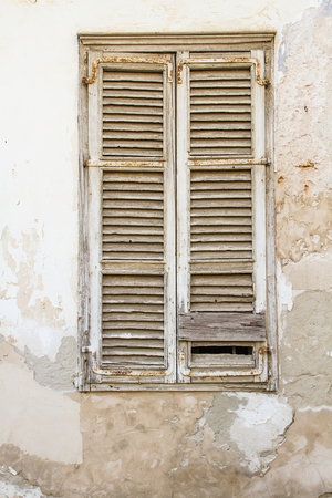 beautiful vintage shutters on the windows of the old house