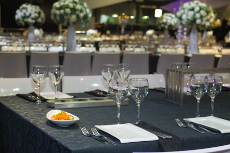 catered: Table set for wedding or another catered event dinner .
