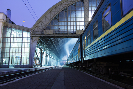 railroad station: The train on the platform of railroad station in Lviv , Ukraine .