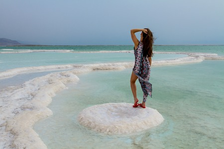 going places: Young woman going to Dead Sea, Israel .