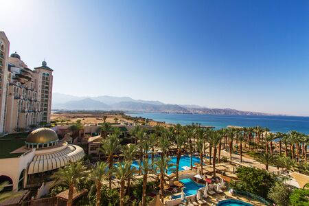 eilat: Eilat, Israel - July 3, 2016: Panoramic view on the central beach of Eilat - famous resort and recreational city in Israel .