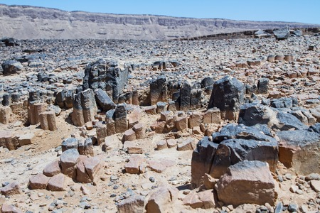 igneous: National geological park HaMakhtesh HaRamon - Ramon Crater is the Largest crater- geological erosion land form in Israel . Solidified igneous rocks .