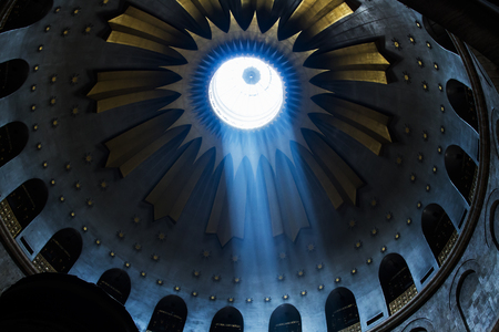 church of the holy sepulchre: Jerusalem , Israel - January 22, 2015: The Holy Sepulchre Church in the Old City of Jerusalem. Light goes through the dome of the church.