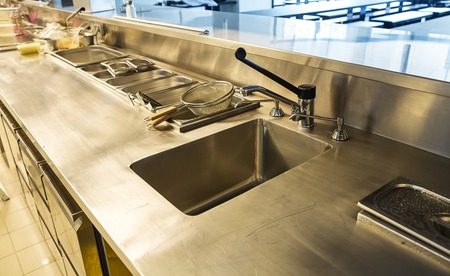 kitchen cabinets: Professional kitchen, view counter in stainless steel . Stock Photo