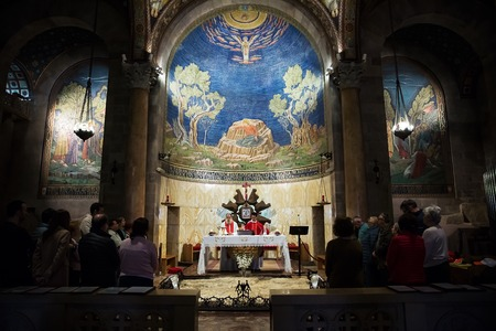 Jerusalem , Israel - January 25 . 2019 : Catholic service in the church of all nations in jerusalem . Church of All Nations also known as the Basilica of the Agony.