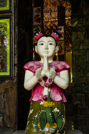 curtsy: Girl statue in Wat Pa Thamma Utthayan, Khonkean, Thailand Stock Photo