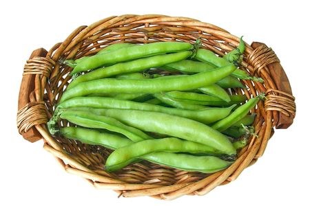 a lot of horse beans in basket isolated on white background photo