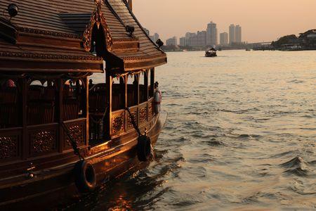Boat in the river at sunset, Bangkok, Thailand. photo