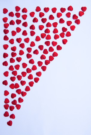 radiosity: Red hearts on white paper.