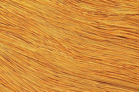 streak plate: Golden color small strings. Stock Photo