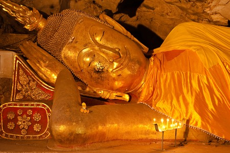 Reclining Buddha image in the cave of light, Petchaburi, Thailand. Stock Photo - 4383372