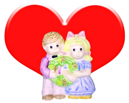 embraced: Couple ceramic doll with big red heart.